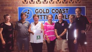 FAAE Director Scott Whimpey present Gold Coast Little Athletics with a First Aid kit as part of their partnership