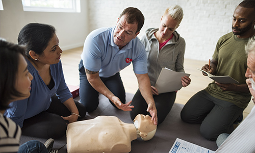 Insructor performing CPR on resuscitation dummy