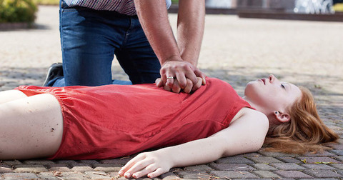 woman having CPR performed on her
