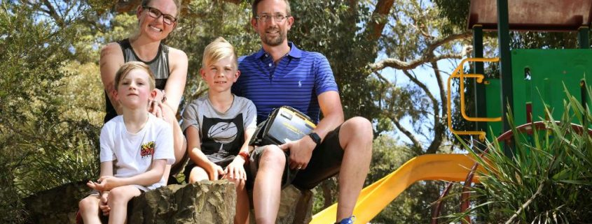family with defibrillator at park