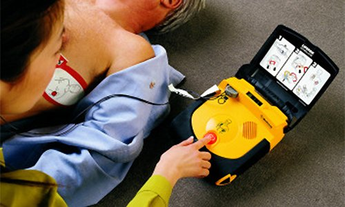 defibrillator being used on a male patient