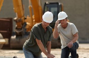 Construction workers perform CPR and call emergency services
