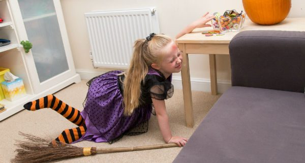 Child in pain after eating too much sugar at halloween