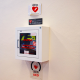 Defibrillator in wall cabinet with signage
