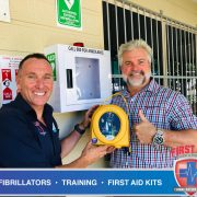 Bede Young and Scott Whimpey with new HeartSine 360p Defibrillator at Koala Coaches