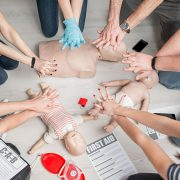 Group learning CPR in first aid course