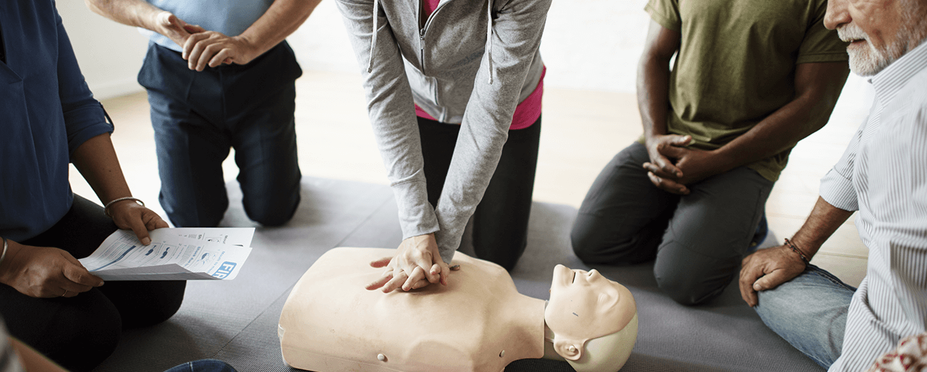 Class learning how to do first aid in a CPR and First Aid Training Course