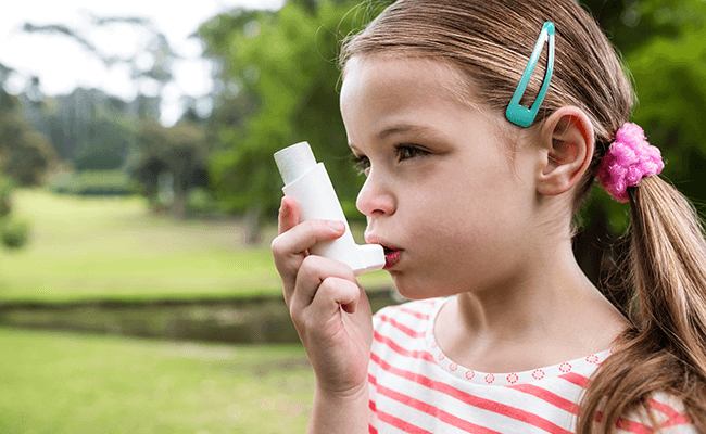 Little girl with Asthma and a Inhaller