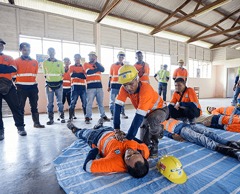 Tradies learning how to perform Low Voltage Rescue in a First Aid Training Course