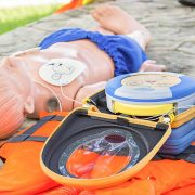 First Aid dummy with defibrillator on in training