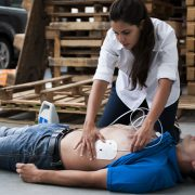 Using defibrillator on construction worker